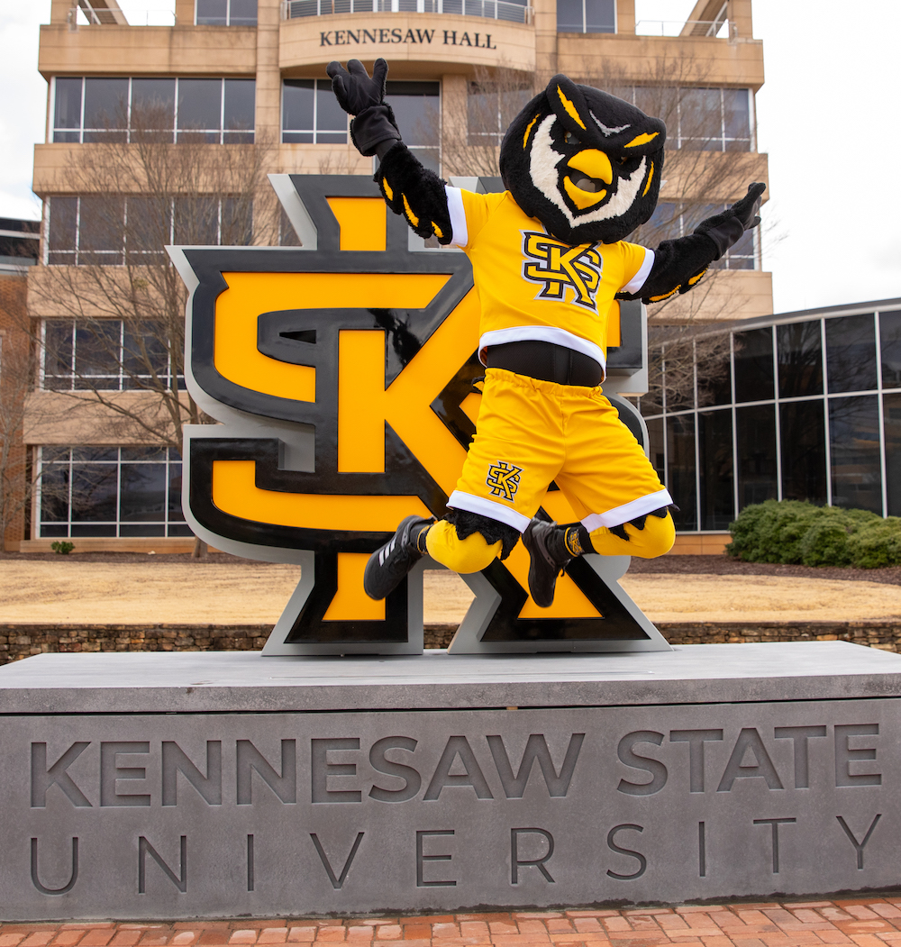 scrappy jumping in front of KSU sign